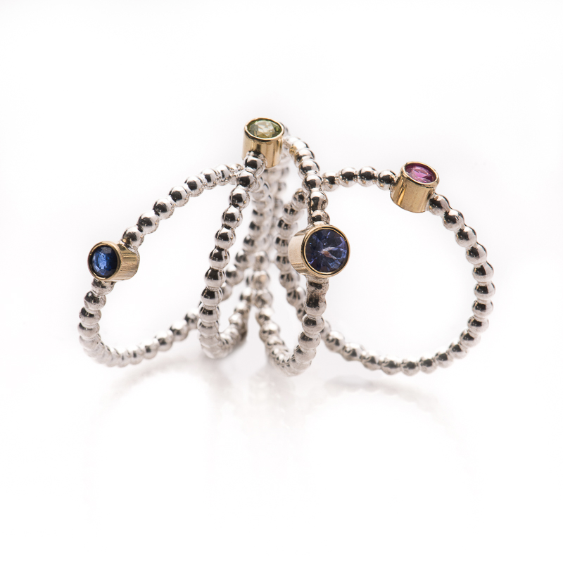 "Rings of the new collection ""Delhi"". Silver and 18 carat gold, with sapphire, peridot, tanzanite or rubis"