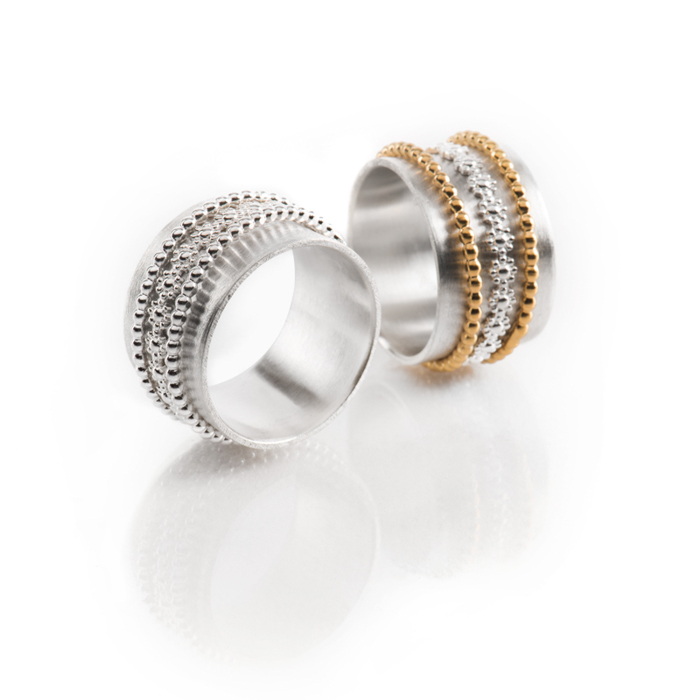 Rings « Spring » in sterling silver and gold-plated, the three central rings are free to move and slide, width 12 mm