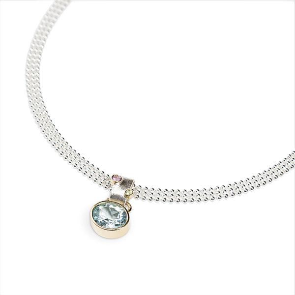 Collier en argent avec pendentif en or 18 cts avec aigemarine, peridot et saphire rose