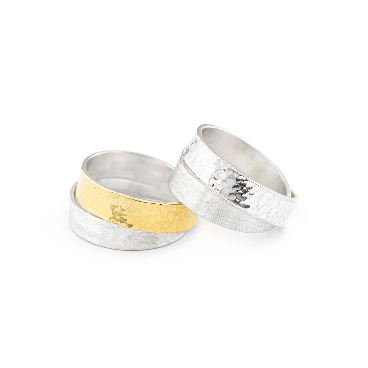 The INFINI rings of the DOTS collection, either entirely in silver or silver/22 cts gold